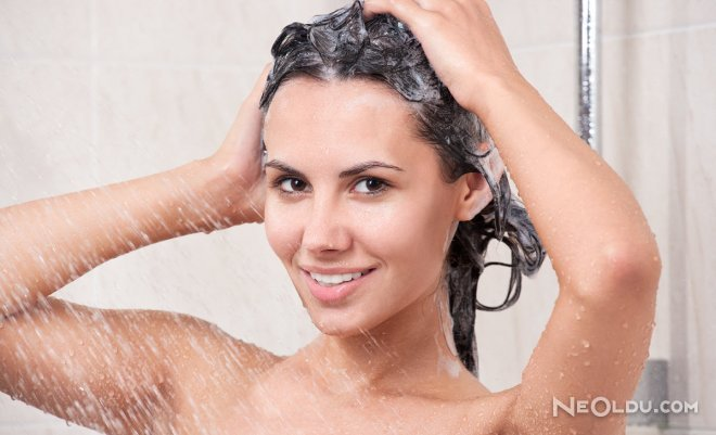 bigstock-young-woman-washing-head-by-s-37586176.jpg