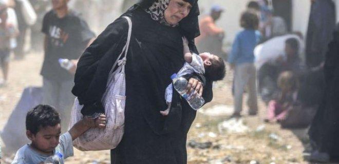 savaştan kaçan anne ve çocukları